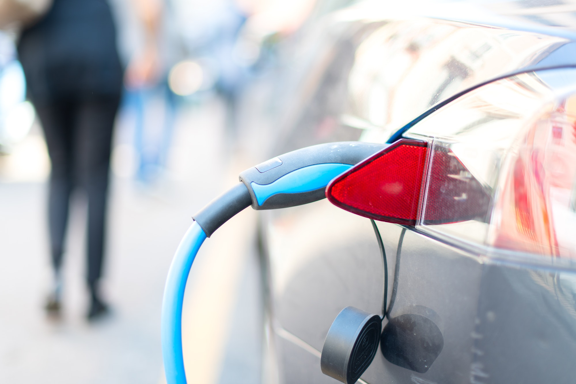 An electric car is charged